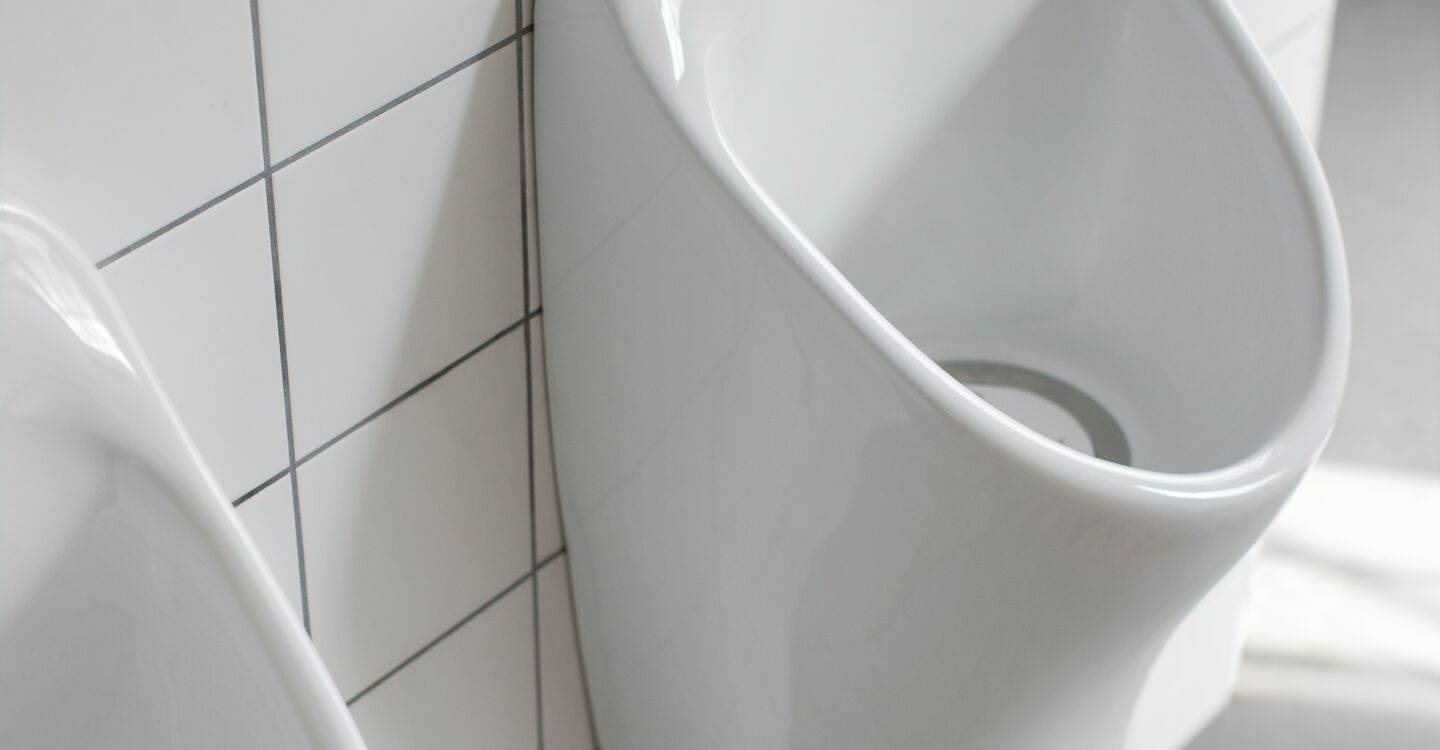 Trough urinal, up to 240cm long, centre outlet