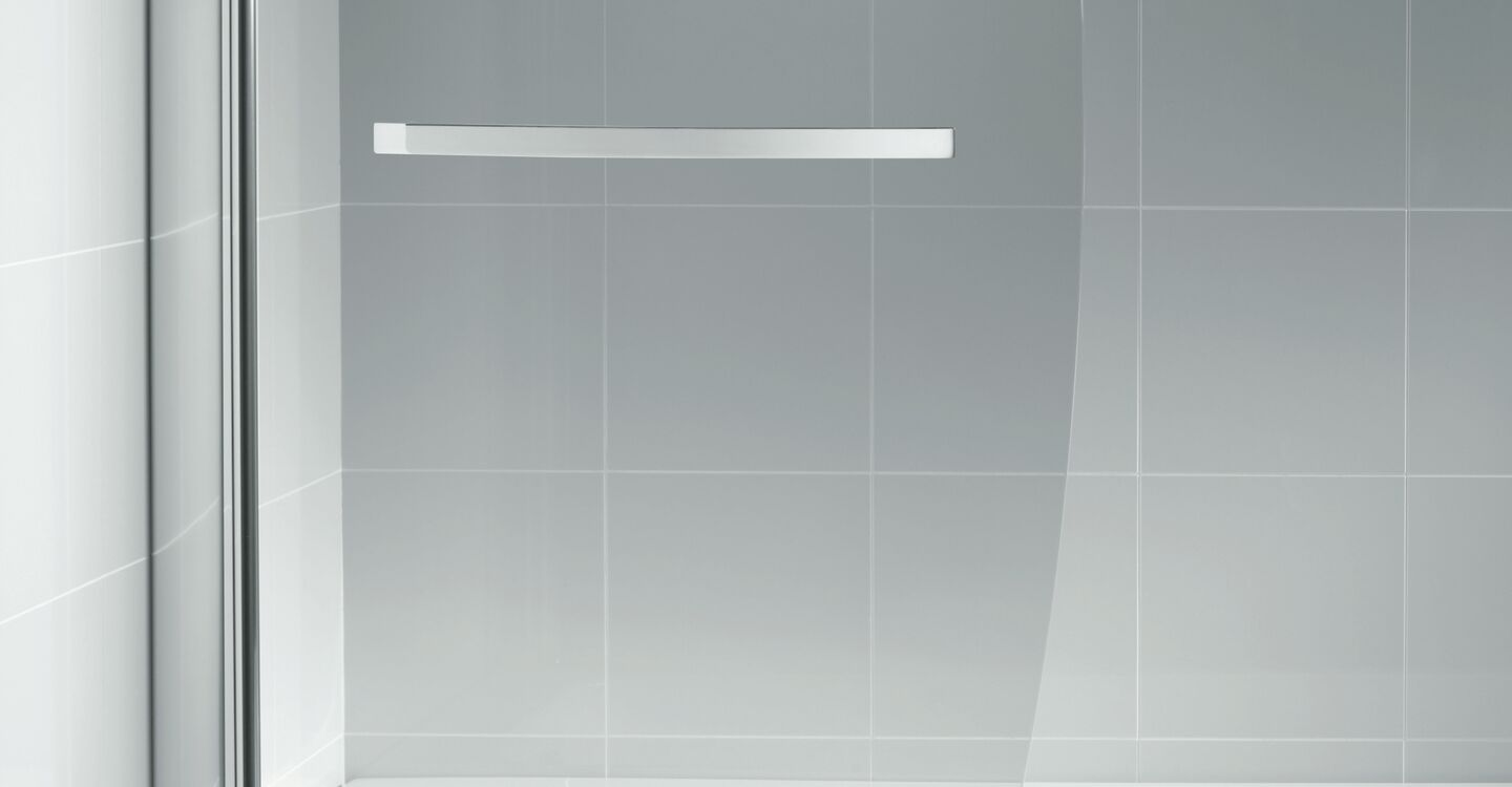 Bow shower bath screen with rail, clear glass